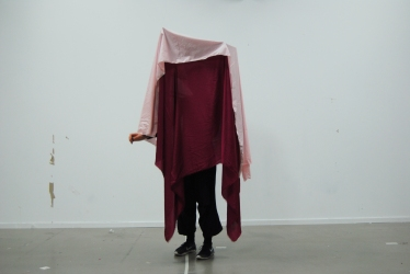 Person Performance in pink and mulled fabric.