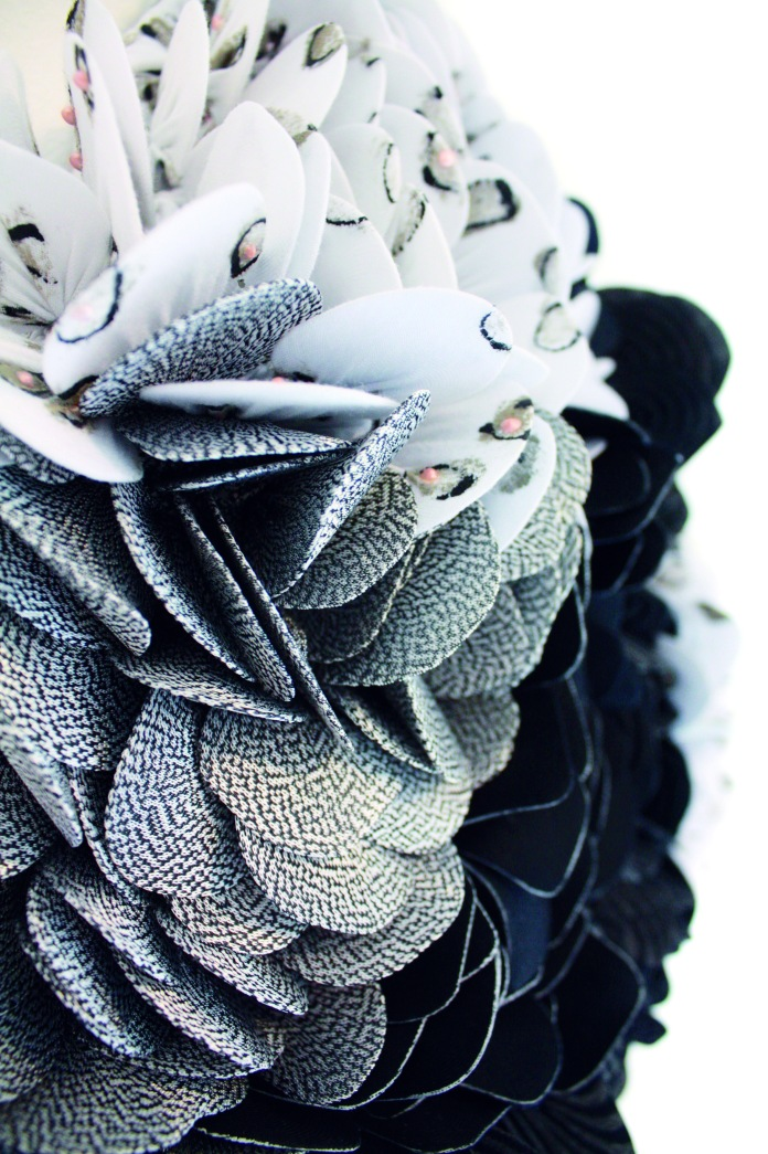 Detail of a textile project, consisting of many small cirkels organised together