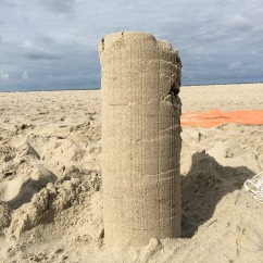 using yarn as a reinforcement for sand